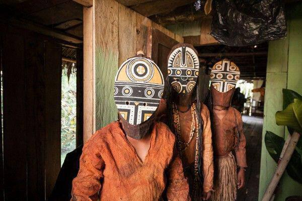Three young boys wear their traditional Miraña tribe costume.