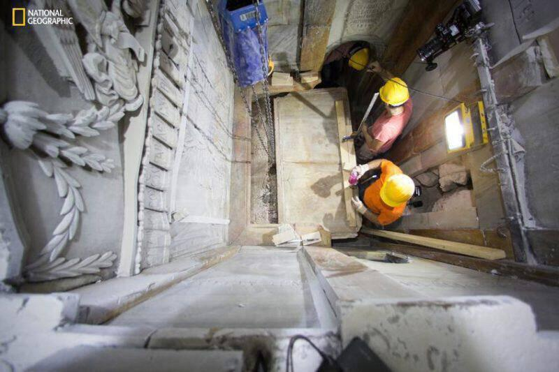 This Wednesday Oct. 26, 2016 shows the moment workers remove the top marble layer of the tomb said to be of Jesus Christ in the Church of Holy Sepulcher in Jerusalem. a restoration team has peeled away a marble layer for the first time in centuries in an effort to reach what it believes is the original rock surface where Jesus' body was laid. Many historians have long believed that the original cave, identified a few centuries after Jesus' death as his tomb, was obliterated ages ago. But an archaeologist accompanying the restoration team said ground penetrating radar tests determined that cave walls are in fact standing _ at a height of six feet and connected to bedrock _ behind the marbled panels of the chamber at the center of Jerusalem's Church of the Holy Sepulchre. (Dusan Vranic/National Geographic via AP)